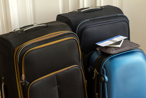 bags packed holiday travel insurance